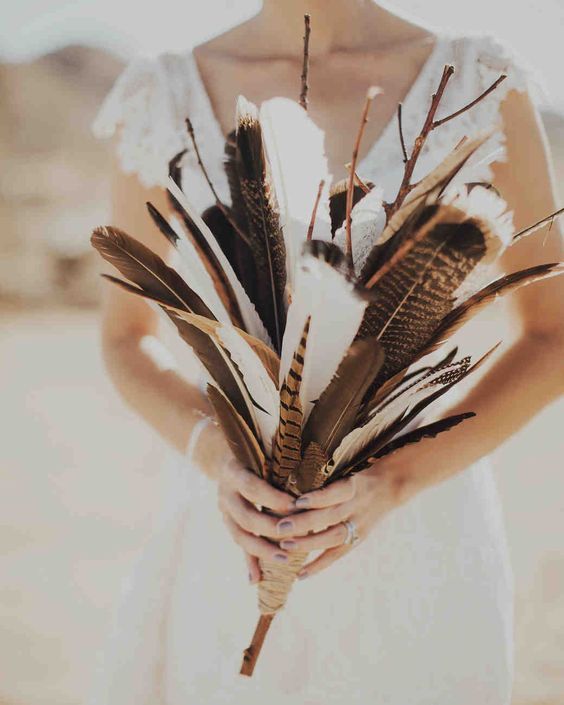 a creative boho wedding bouquet of feathers and branches is a cool and very easy idea that you can compose yourself anytime