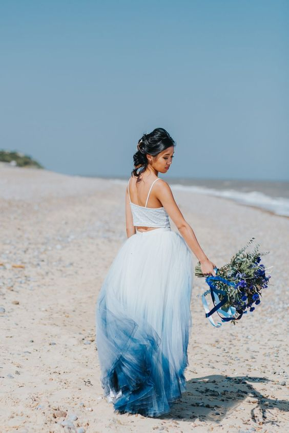 a crop top with spaghetti straps, a dip dye skirt in white and deep blue for a coastal wedding