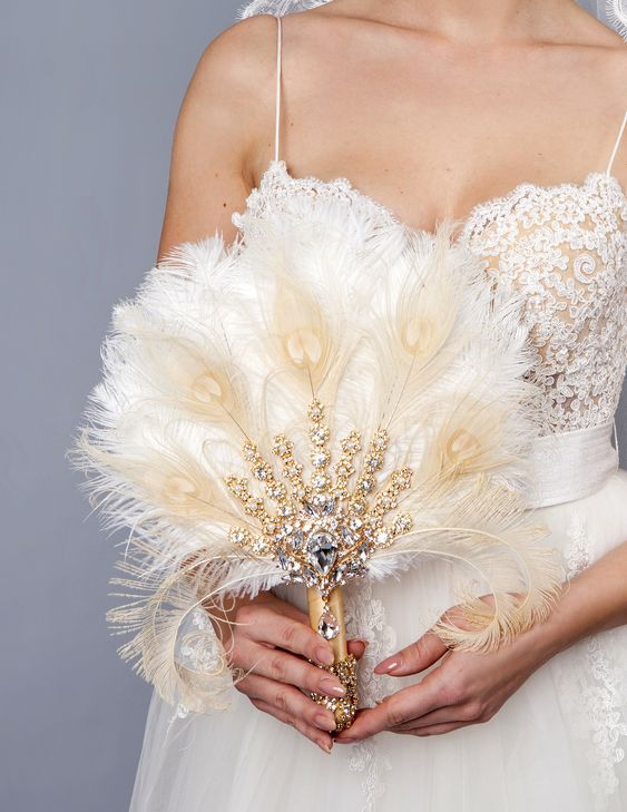 a feather fan wedding bouquet with heavy embellishments is a very chic and glam idea for a bride who loves vintage
