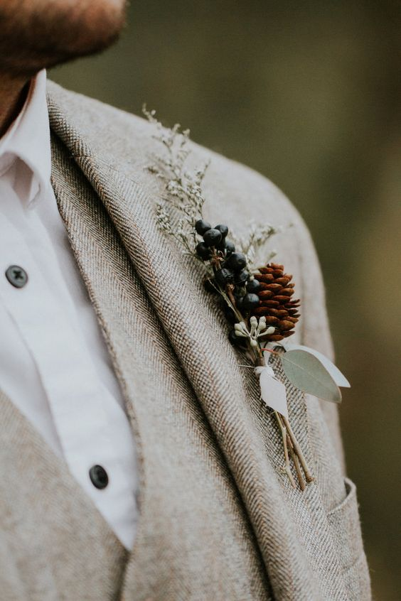 a forest wedding boutonniere with privet berries, eucalyptus, herbs and a pinecone is a lovely idea for fall