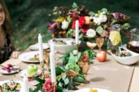 a gorgeous al fresco fall bridal shower setting with a greenery and bloo runner, apples and gilded touches