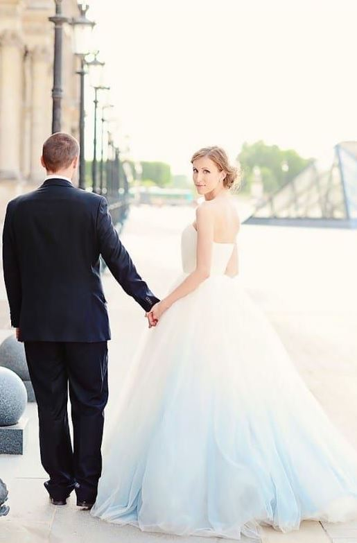 a gorgeous white and blue wedding ballgown with a layered skirt is a fantastic idea to rock