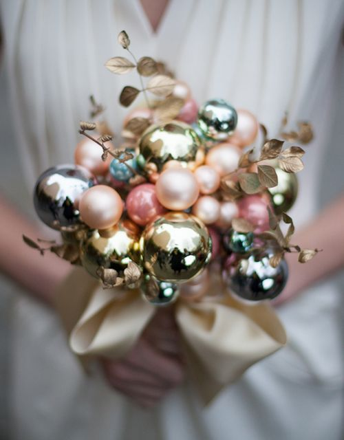 a lovely matte and shiny Christmas ornament wedding bouquet with gilded foliage and gold ribbons is a delicate idea for a winter bride