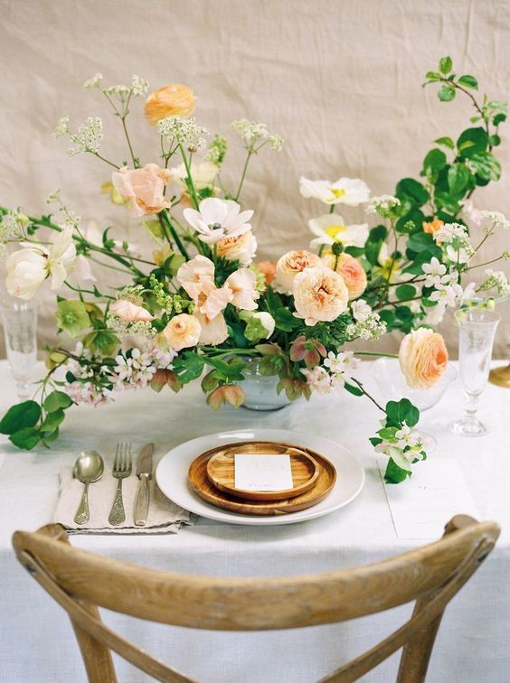 a chic modern wedding tablescape in peachy tones