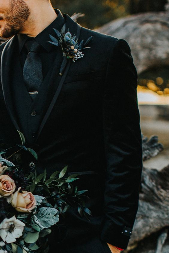 a moody wedding boutonniere with thistles, dark leaves, berries is a perfect idea for a Halloween wedding