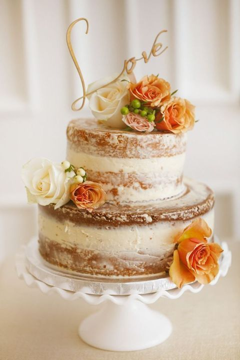 a naked bridal shower cake with orange and white blooms and an elegant calligraphy topper