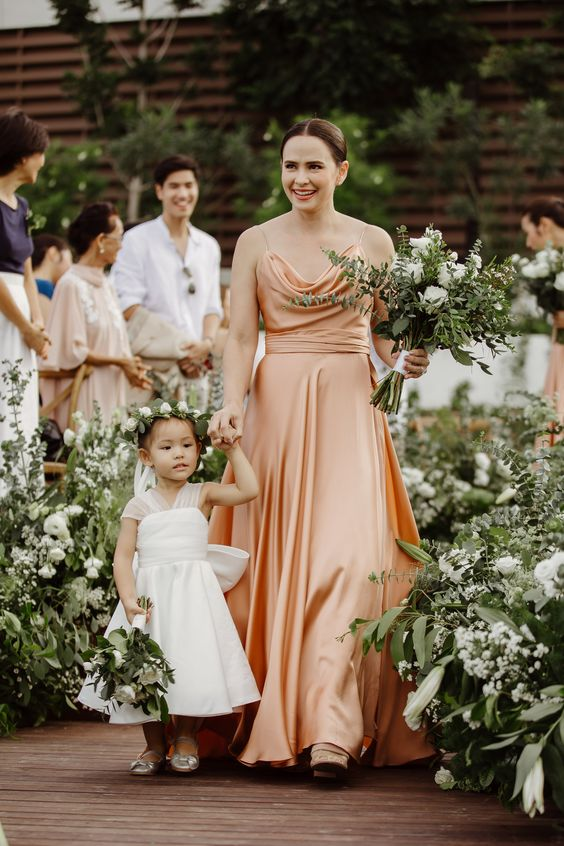 a peachy A-line bridesmaid dress with a cowl bodice and spaghetti straps is a refined and chic option