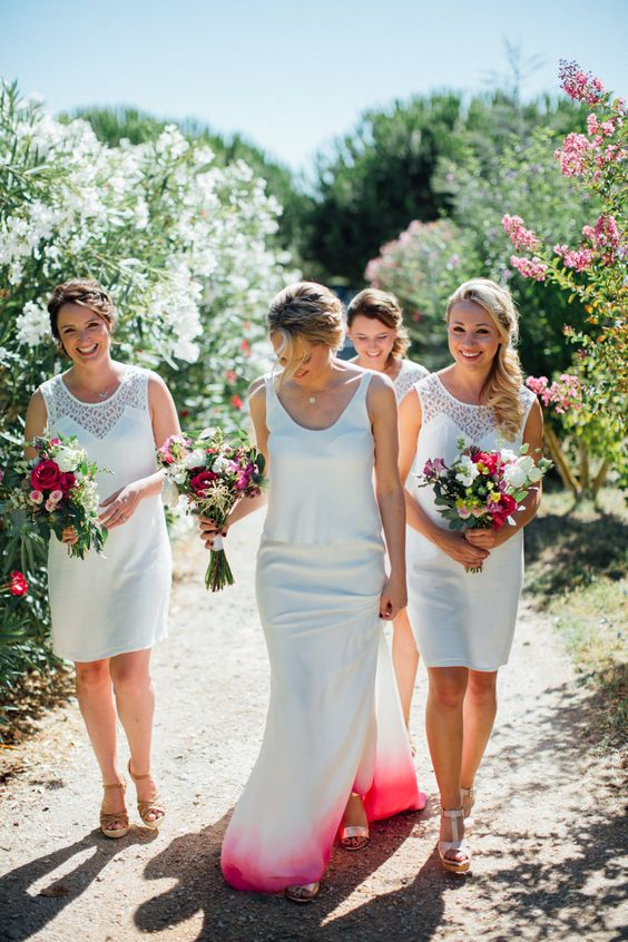 a plain mermaid wedding dress with thick straps, a scoop neckline and a dip dye white and pink skirt