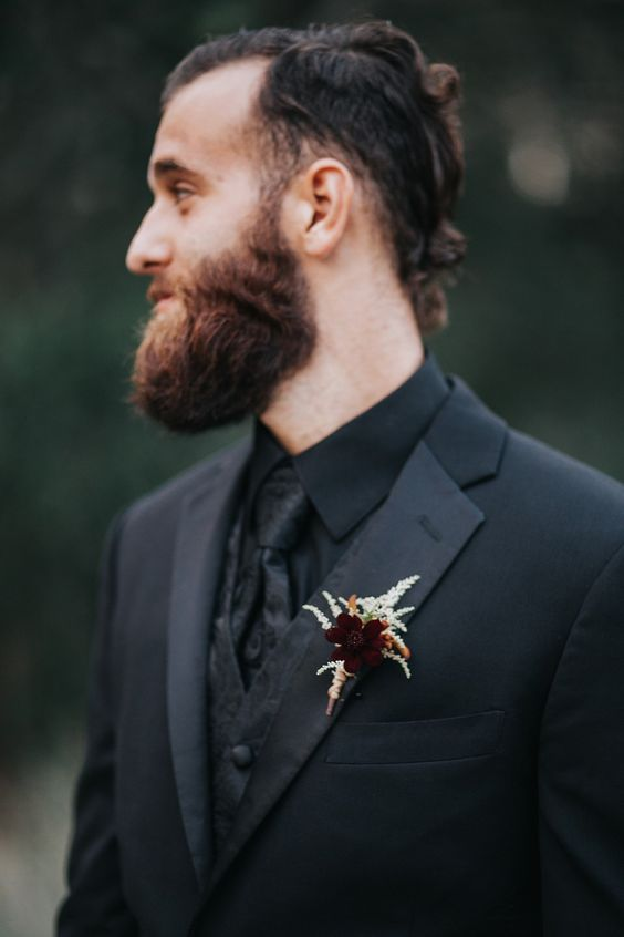 a pretty and laconic wedding boutonniere with a burgundy bloom and pale herbs is perfect for a Halloween wedding