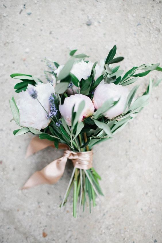 a pretty and simple wedding bouquet of white and blush peonies, lilac and greenery with blush ribbons is chic