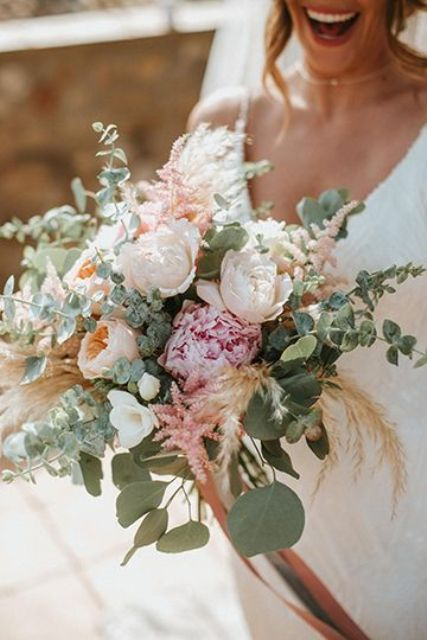 a pretty pastel wedding bouquet of blush and pink peonies, astilbe, wheat and eucalyptus is a lovely idea for spring