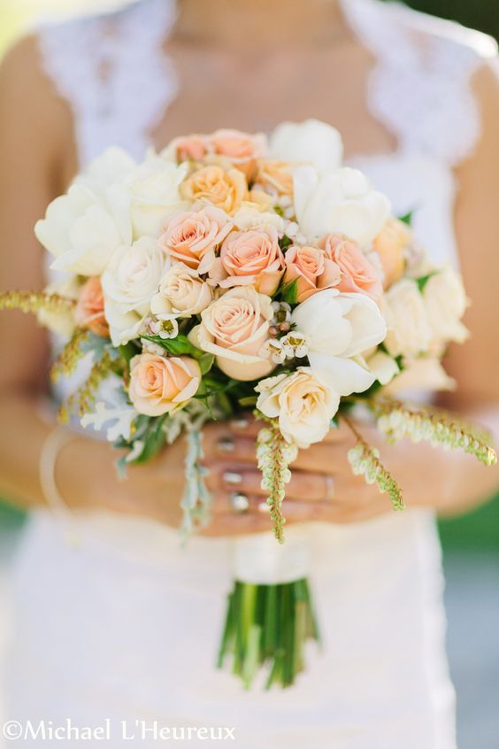 a pretty peach and cream wedding bouquet with greenery and pale foliage is a refined and cool idea for a bride