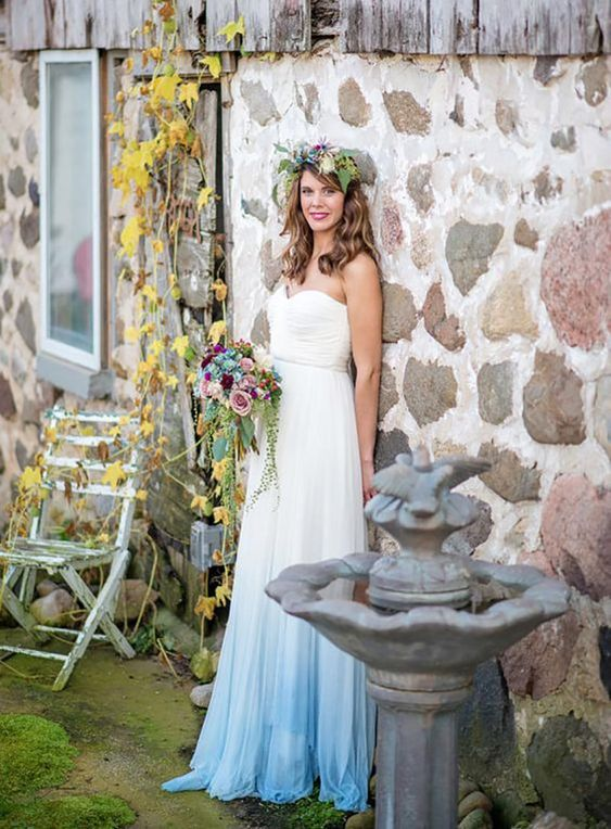 a strapless A-line wedding dress with a dip dye blue skirt and a draped bodice for a romantic look