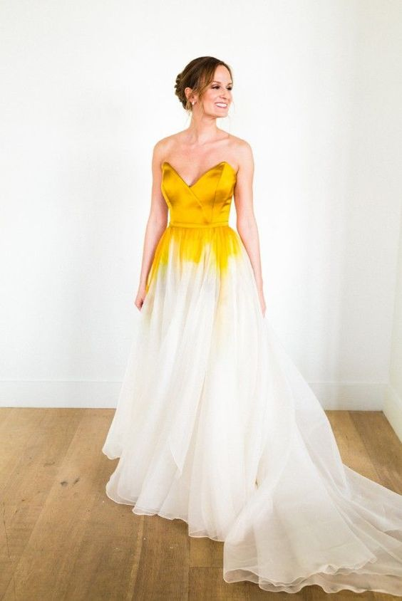 a strapless gold and white dip dye wedding dress with a train is a bold and refined idea for a chic bride