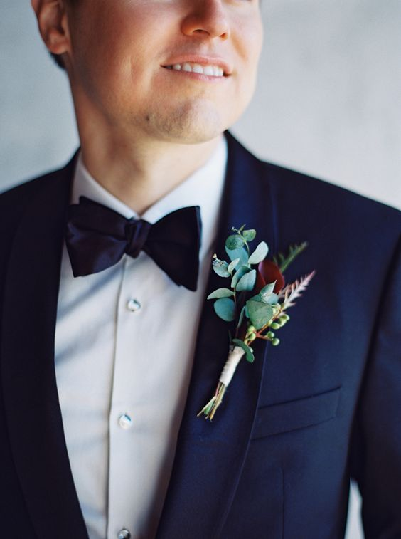 a stylish fall wedding boutonniere with a burgundy bloom and eucalyptus is a timeless idea for many elegant weddings