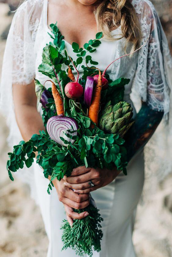 a vegan wedding bouquet of radish, carrots, onions, artichokes, greenery is a fun and cool idea for a farmhouse bride