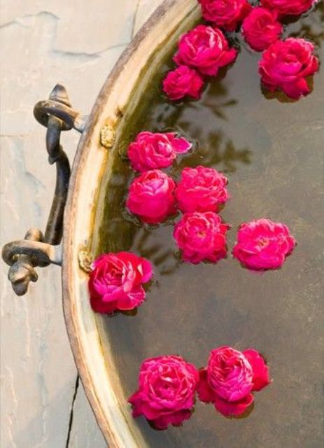 a vintage bowl with floating hot pink blooms is a lovely idea for a bold wedding with a vintage feel