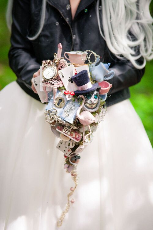 a whimsical Alice in Wonderland wedding bouquet of various elements that are inspired by the book is a jaw-dropping idea