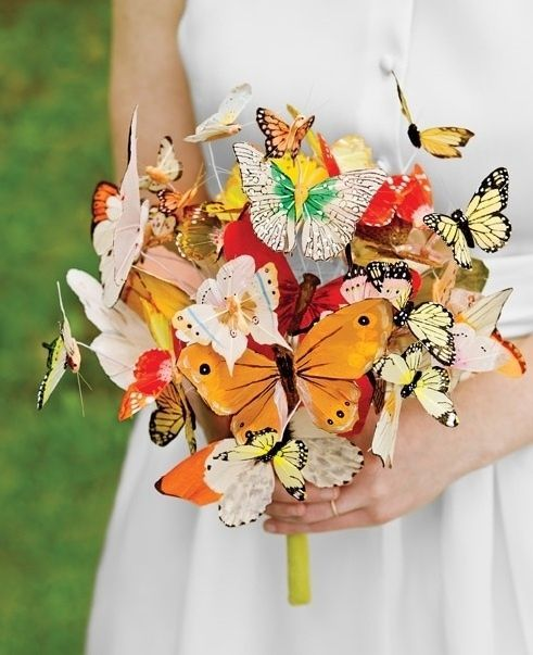 a whimsical and dreamy wedding bouquet made of paper butterflies is a very bright and cool idea for a summer bride