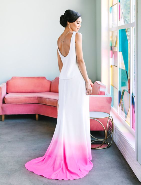 an A-line plain dip dye wedding gown with a cutout back and a pink edge with a train plus a back necklace