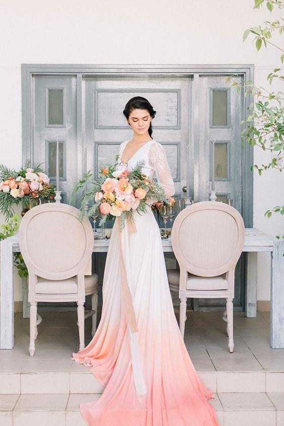 an elegant dip dye wedding dress with a lace bodice, lace sleeves and a pink skirt with a train is wow