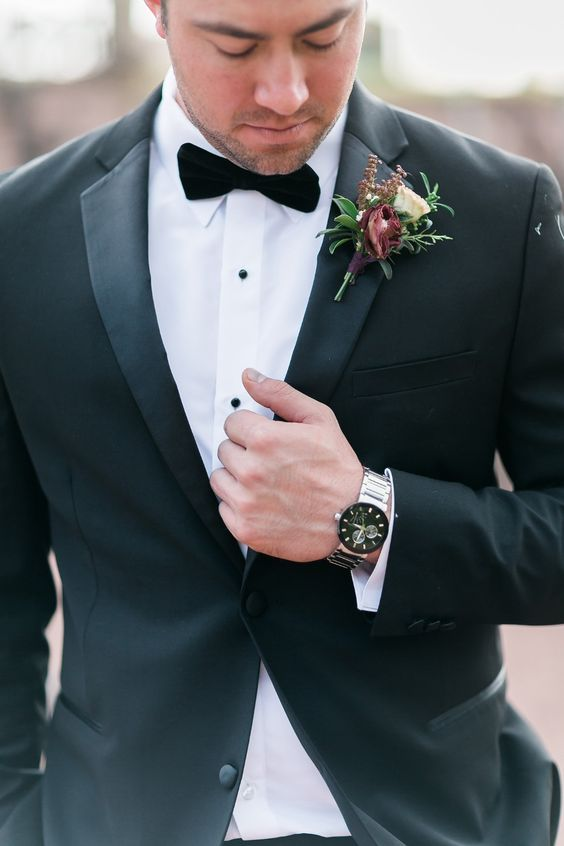 an exquisite fall wedding boutonniere with white and burgundy blooms, greenery and mini flowers is very chic