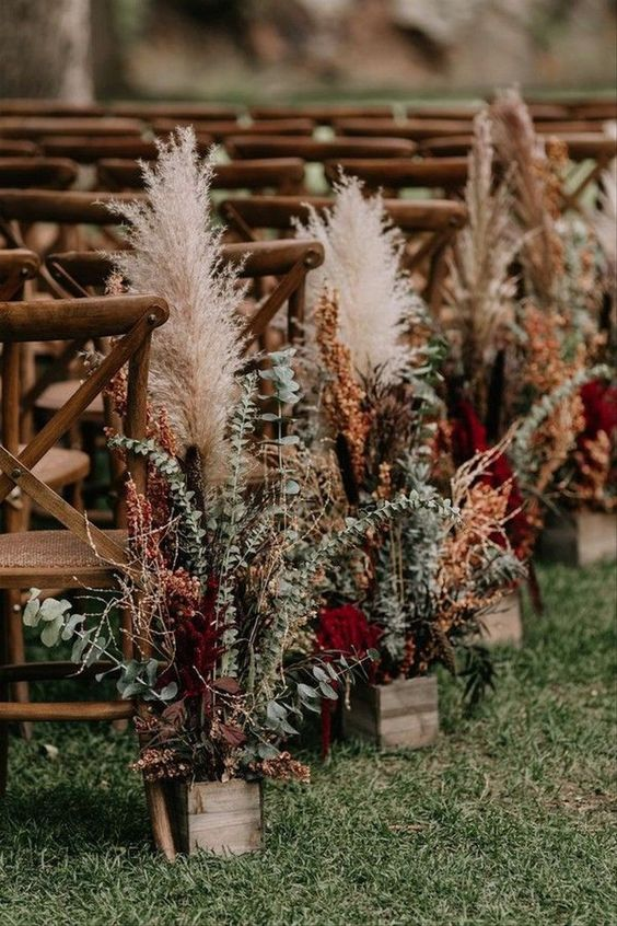 bright fall boho arrangements of burgundy blooms, eucalyptus, pampas grass in wooden boxes are great