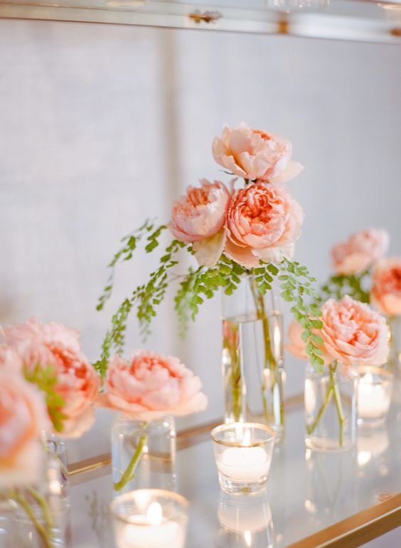 peachy peonies in clear vases and candleholders for refined and chic wedding decor