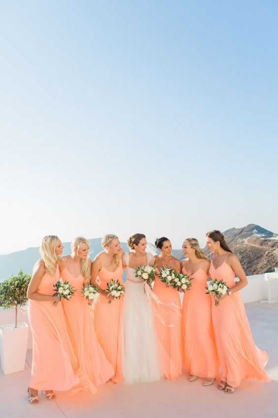 peachy pink A-line bridesmaid dresses with V necklines and spaghetti straps are a lovely solution for a summer wedding