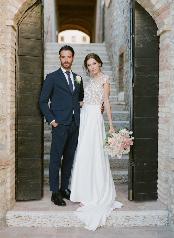 a beautiful A line wedding dress with a floral applique bodice with cap sleeves and a plain skirt