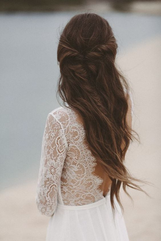 a beautiful half updo with a messy twisted braid and waves down will effortlessly finish off your bridal look
