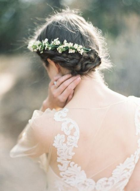 a braided side updo with a simple top and a fresh flower hairpiece is great for a delicate and a bit boho infused bride