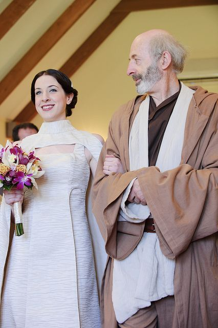 a bride dressed like Leia and her father dressed like a Jedi for a Star Wars themed wedding