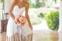 a chic modern strapless wedding dress in white with a gold sequin skirt is a stunning idea for a modern glam-loving bride