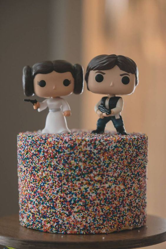 a cool funfetti wedding cake with Leia and Han solo toppers for a bold and fun Star Wars wedding