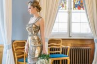a fantastic art-deco inspired wedding dress with a fitting silhouette, wide straps, a small train and rhinestones