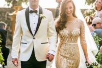a gold sheath wedding dress with an illusion neckline, long sleeves and a sash to highlight the waist