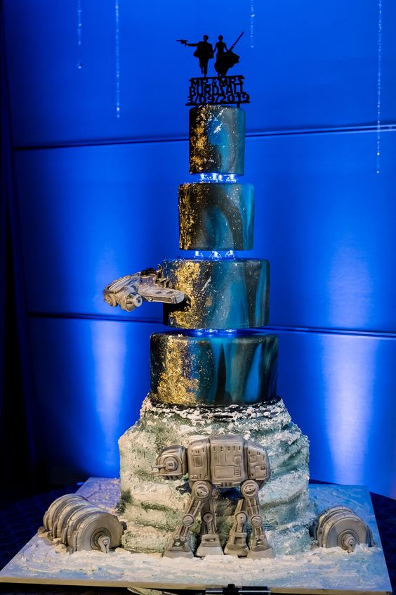 a jaw-dropping Star Wars wedding cake with a galaxy look, Millenial Falcon, Leia and Han silhouettes and much more