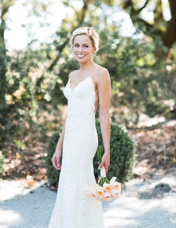 a lace sheath vineyard wedding dress on spaghetti straps with a cutout back is a chic and refined idea