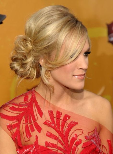 a messy twisted side bun with a volume on top and wavy side bangs is an elegant and refined option