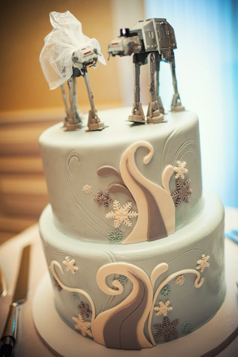 a mint-colored winter wedding cake with snowflakes and epic toppers will make a bold statement at your Star Wars wedding