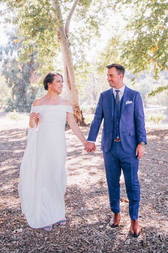 a modern plain off the shoulder sheath wedding dress with a train for a modern vineyard bride