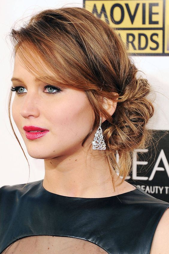 a simple and chic side messy bun and a volume on top plus some locks down is effortless and refined
