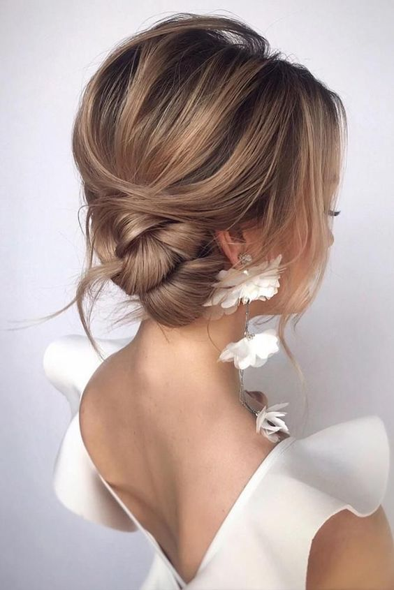 a stylish and elegant side twisted bun with a volume on top, some locks down and a bit of mess for a gorgeous look