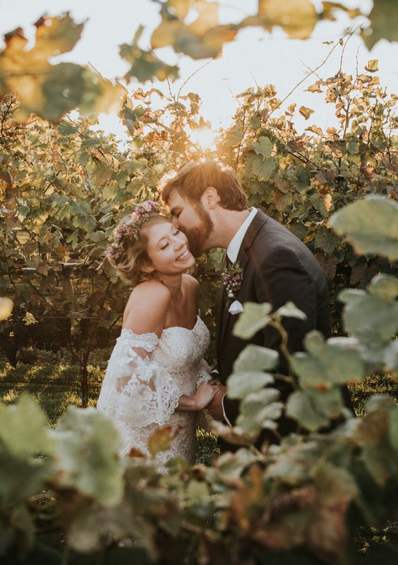 a very cute and romantic wedding portrait right in the vines is a cool solution that is out of the box