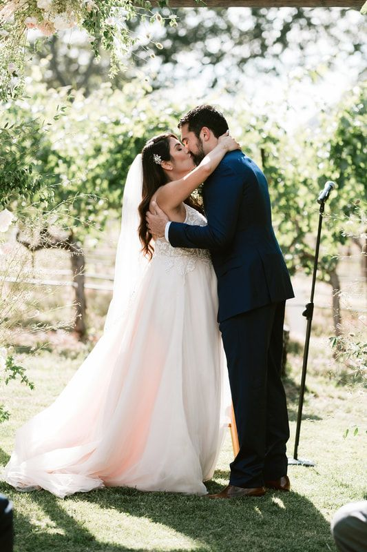 a vineyard wedding ceremony in the vines is a cool idea - you don't have to make a backdrop or a vineyard arch if you have vines