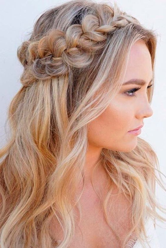 a wavy half updo with a fishtail braided halo and waves down is very romantic and very chic