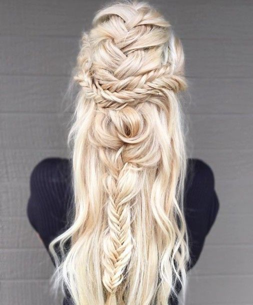 a whimsical half updo with several types of braids located horizontally and vertically, with waves