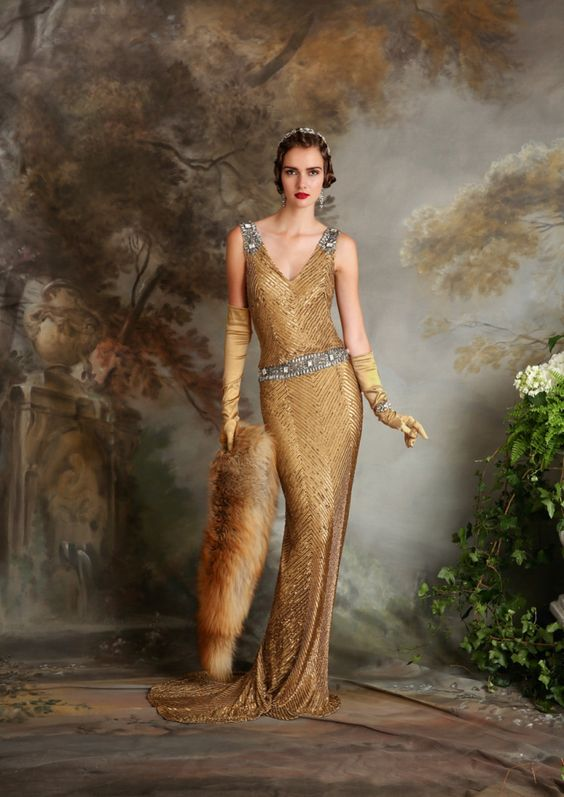an art deco gold sequin wedding dress with embellished silver straps and a sash plus a train and a shawl