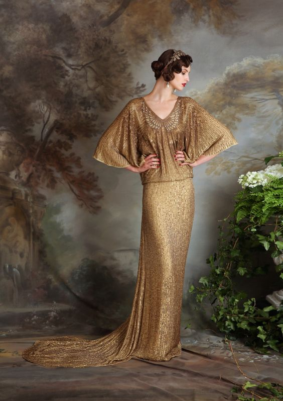 an art deco gold wedding dress with a draped bodice, an embellished neckline, wide short sleeves and a train